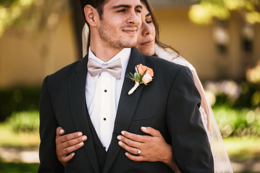 Brides holds her new husband tightly.