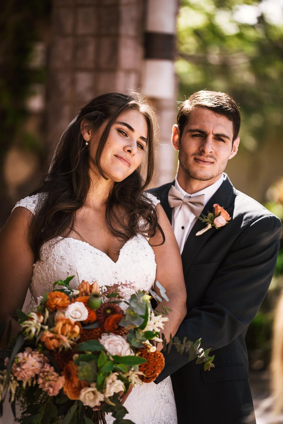 Stunning bride and groom pose to create beautiful wedding photos.