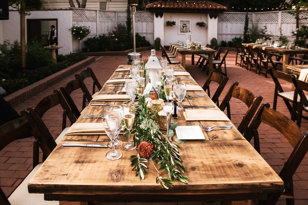 Rustic Wooden tables and floral arrangements at this Darlington House wedding.