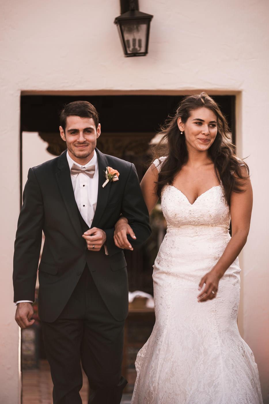 Newlyweds make their grand entrance at their Darlington House reception.