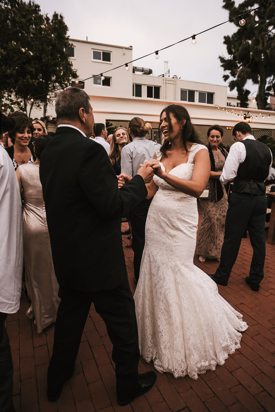 Bride dances with her wedding guests.