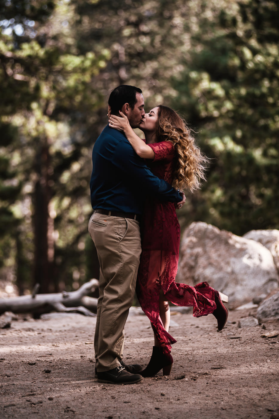 Engaged couple kisses passionately during their photo session.