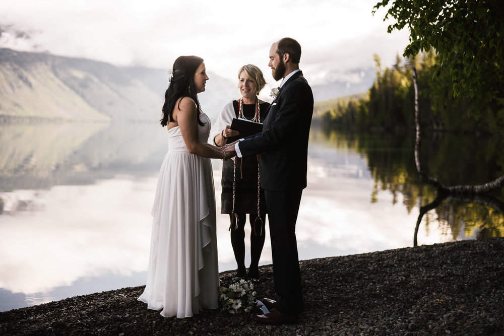 Beautiful wedding ceremony on the edge of Lake Mcdonald in Glacier National Park.