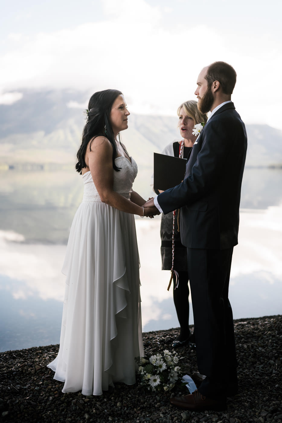 Adventurous elopement on the lake shore in Glacier National Park.