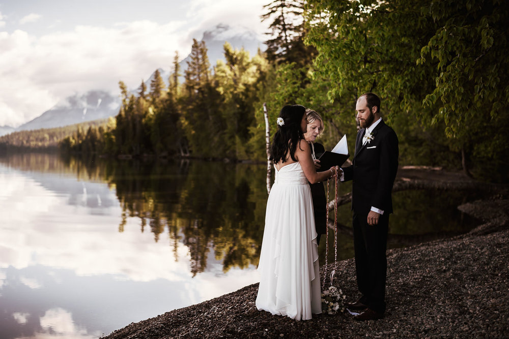 Couple ties the knot during a beautiful outdoor ceremony.