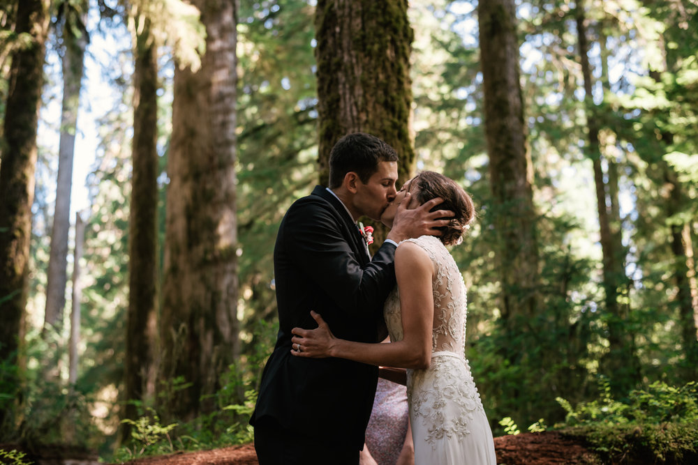 First kiss during this touching elopement to the Hoh Rainforest in Olympic National Park.