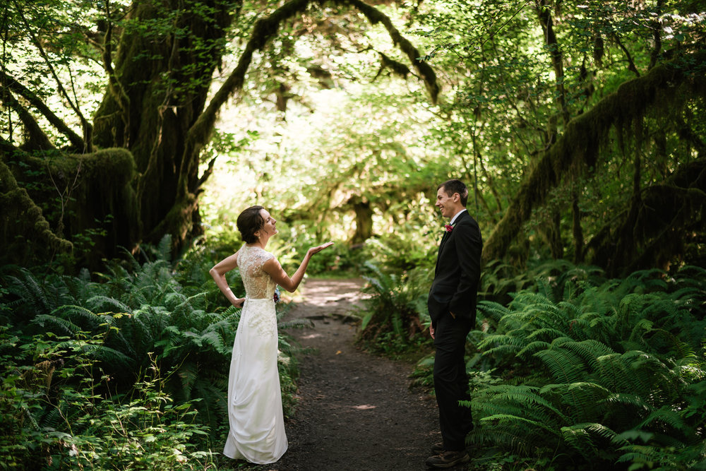 Playful couples blows kisses to each other during their wonderful elopement to Olympic National Park.