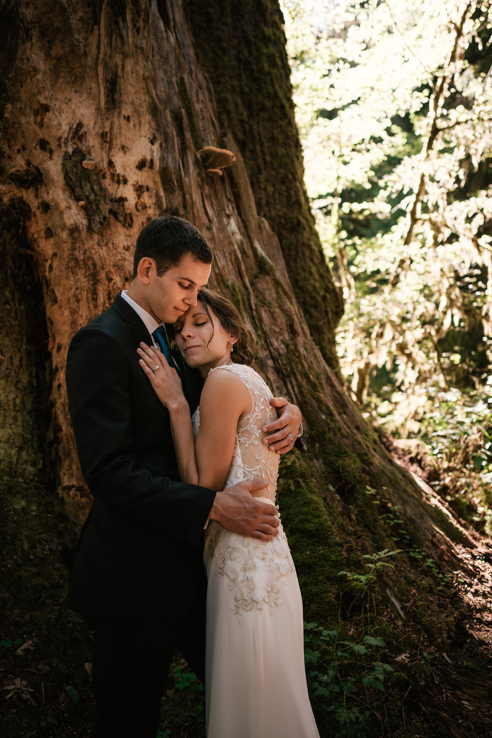 Newlyweds take a moment to enjoy their love after an intimate ceremony in Hoh Rainforest.