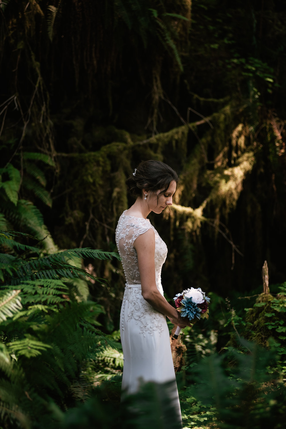Beautiful bridal portrait among the green ferns of the Pacific Northwest.