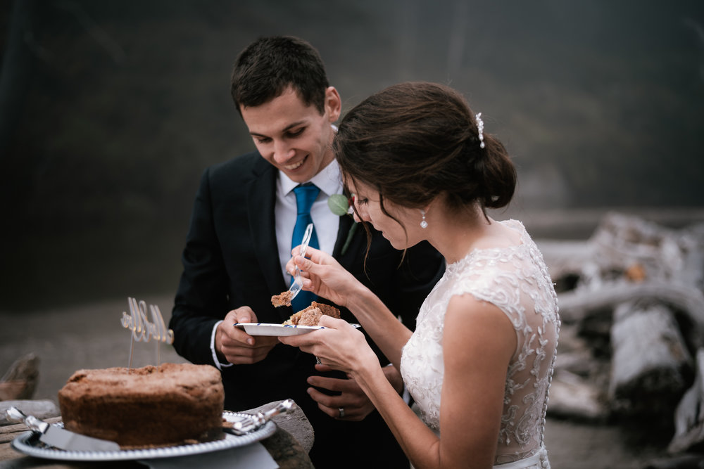 Wedding cake cutting ceremony on the foggy Washington coast.