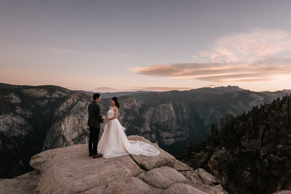 Bride and groom elope to Yosemite's Taft point for a romantic sunrise ceremony.