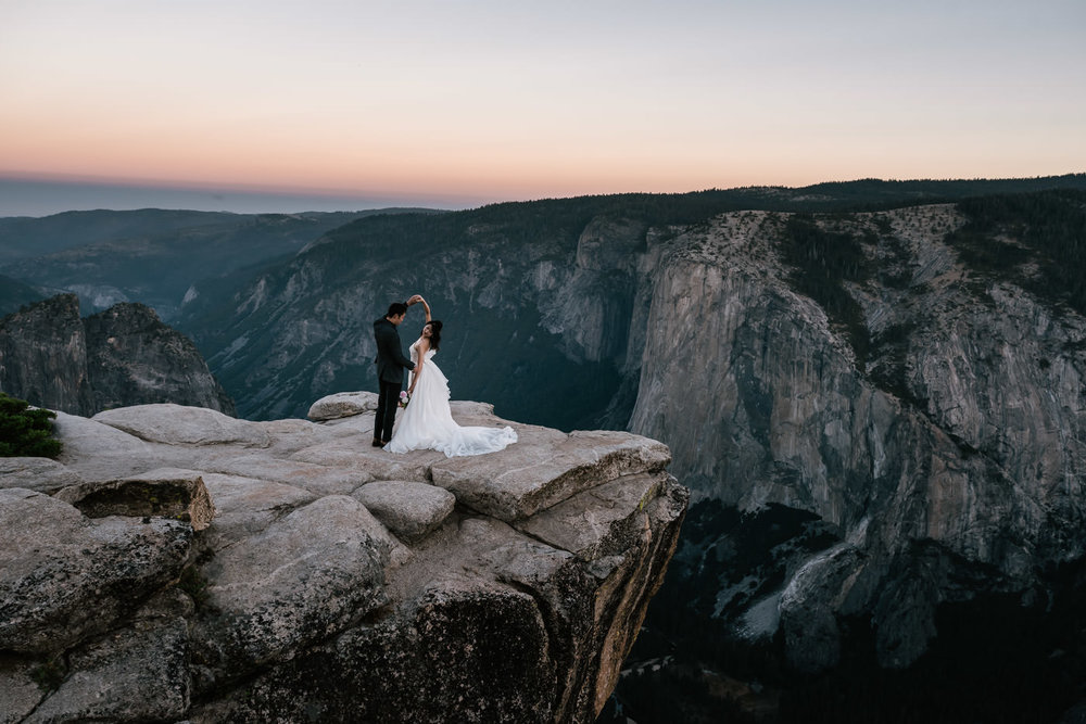 Newlyweds dance on the majestic cliffs of the Yosemite Valley.