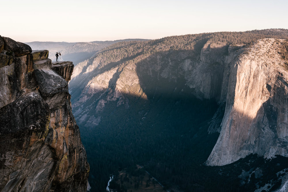 Newlyweds dance on the cliffside of Taft Point in the Sierra mountians.