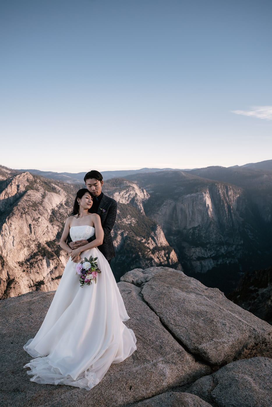 Classic wedding photo on the cliffs of Taft Point.