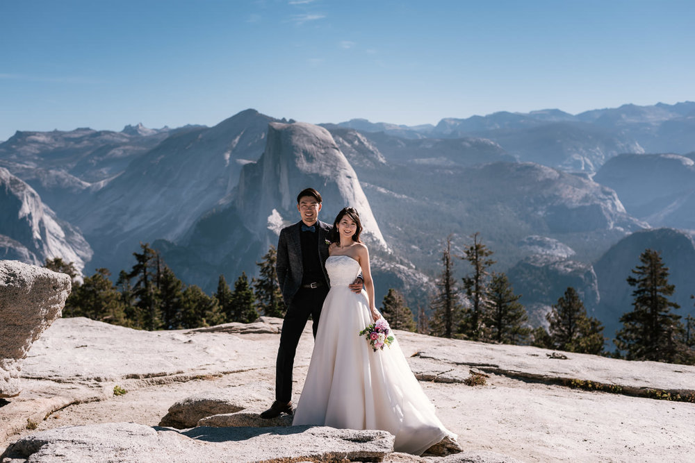 Beautiful wedding photo in front of the world famous Half Dome.