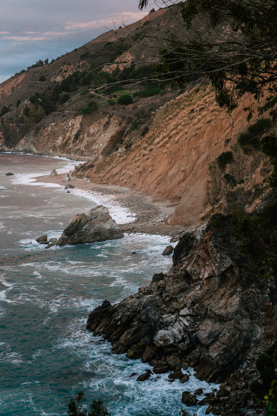 The waves break on the rugged coastline of Big Sur's Mcway waterfall area.