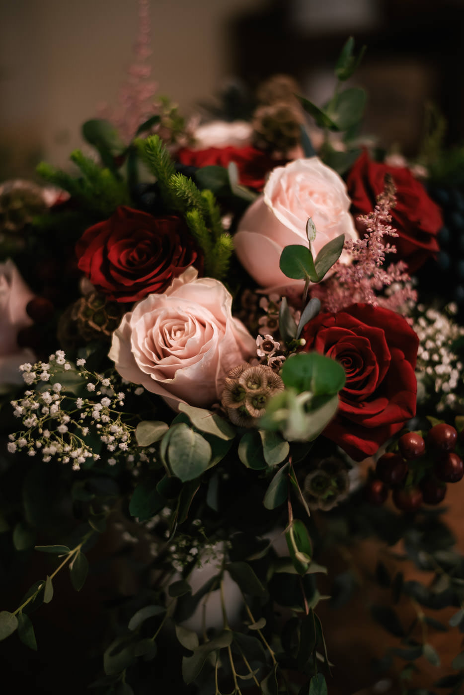 Beautiful pink and red roses accented with eucalyptus leaves makes for a beautiful bridal bouquet.