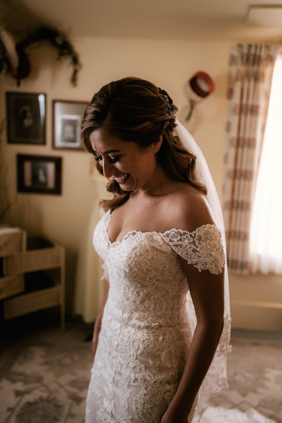 Bride shows off her beautiful wedding dress with its' delicate lace details.