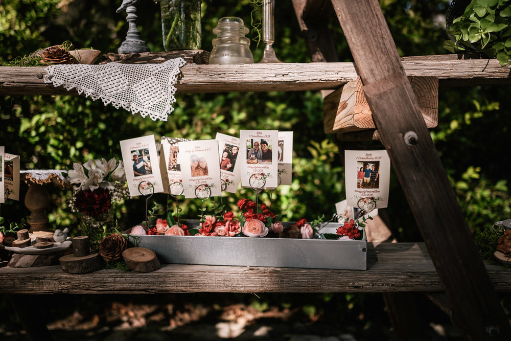 Photos of the wedding guests make for a personalized seating chart.