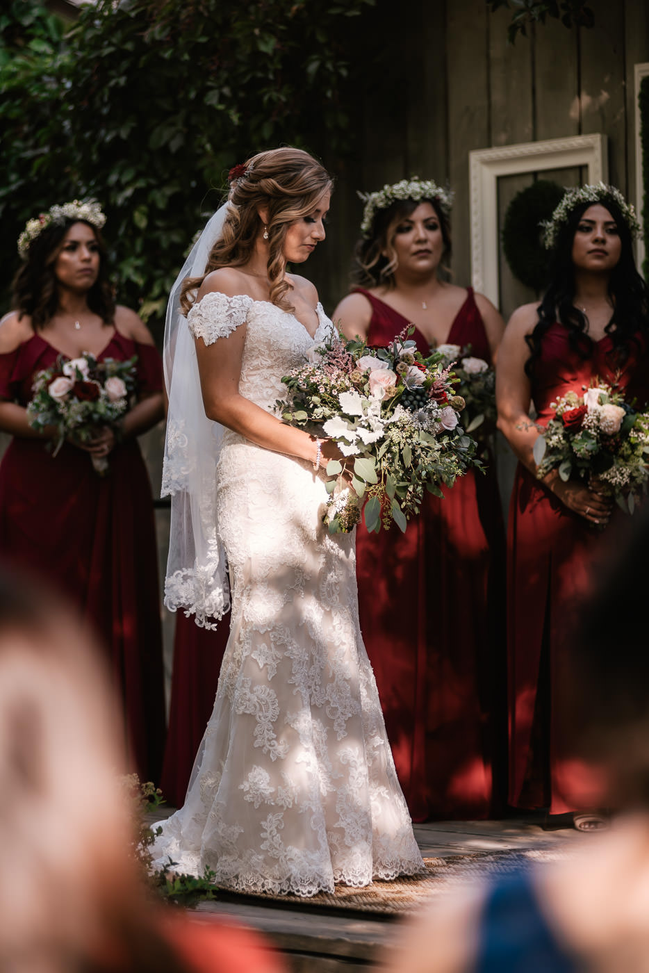 Beautiful bride holds her bouquet and prepares to say her vows.
