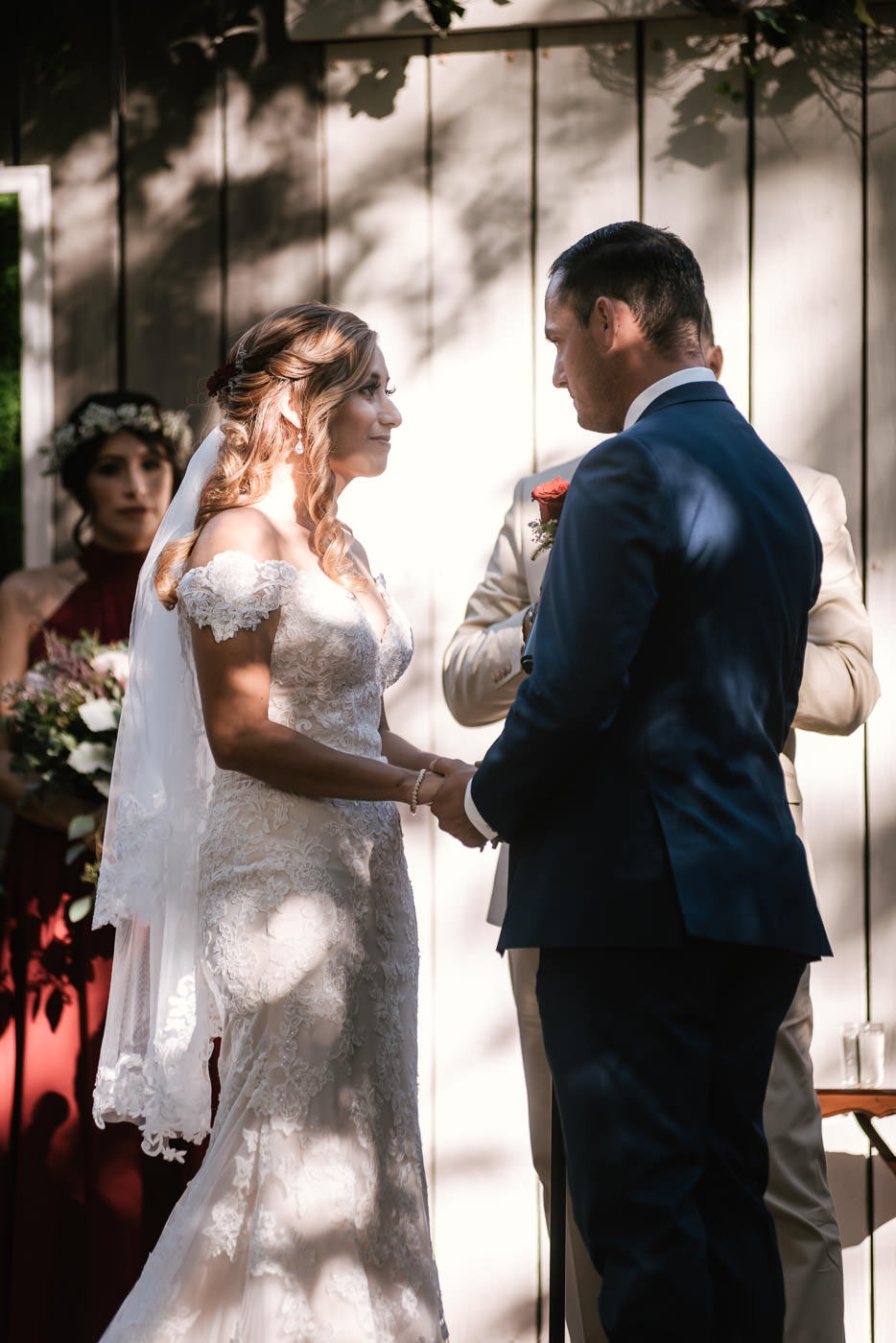 Bride looks into her grooms eyes as they say their marriage vows.