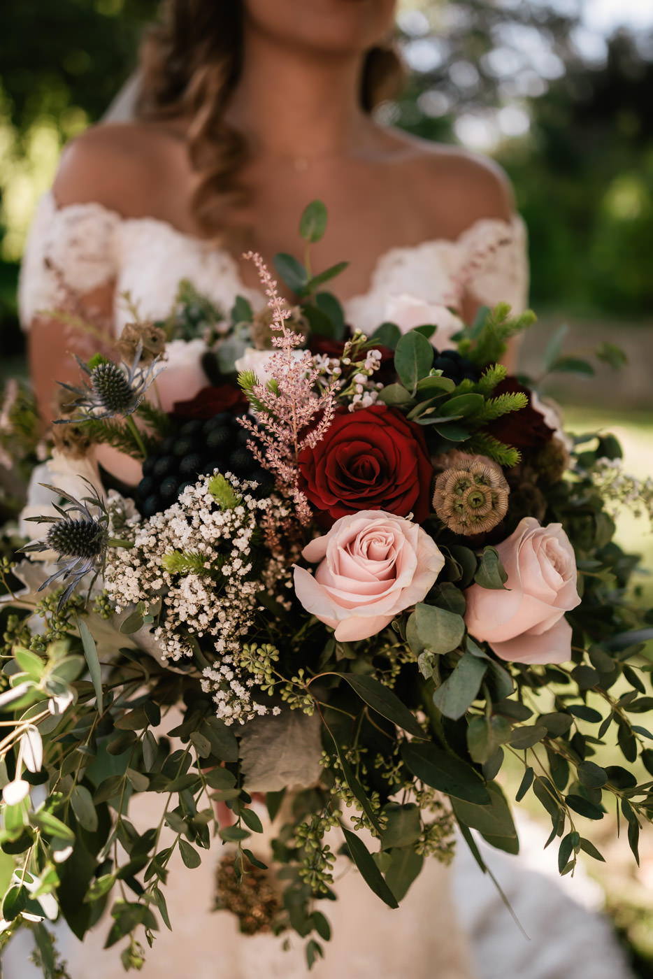 Beautiful rose bouquet with eucalyptus other rustic details.