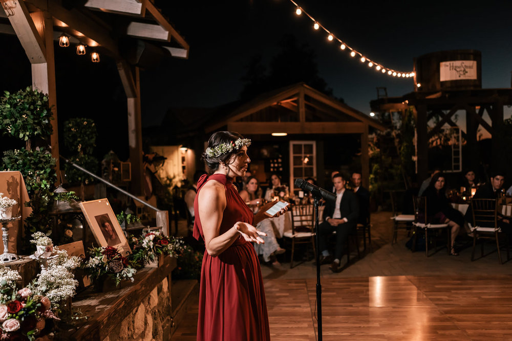 Maid of Honor gives a touching speech at the reception.