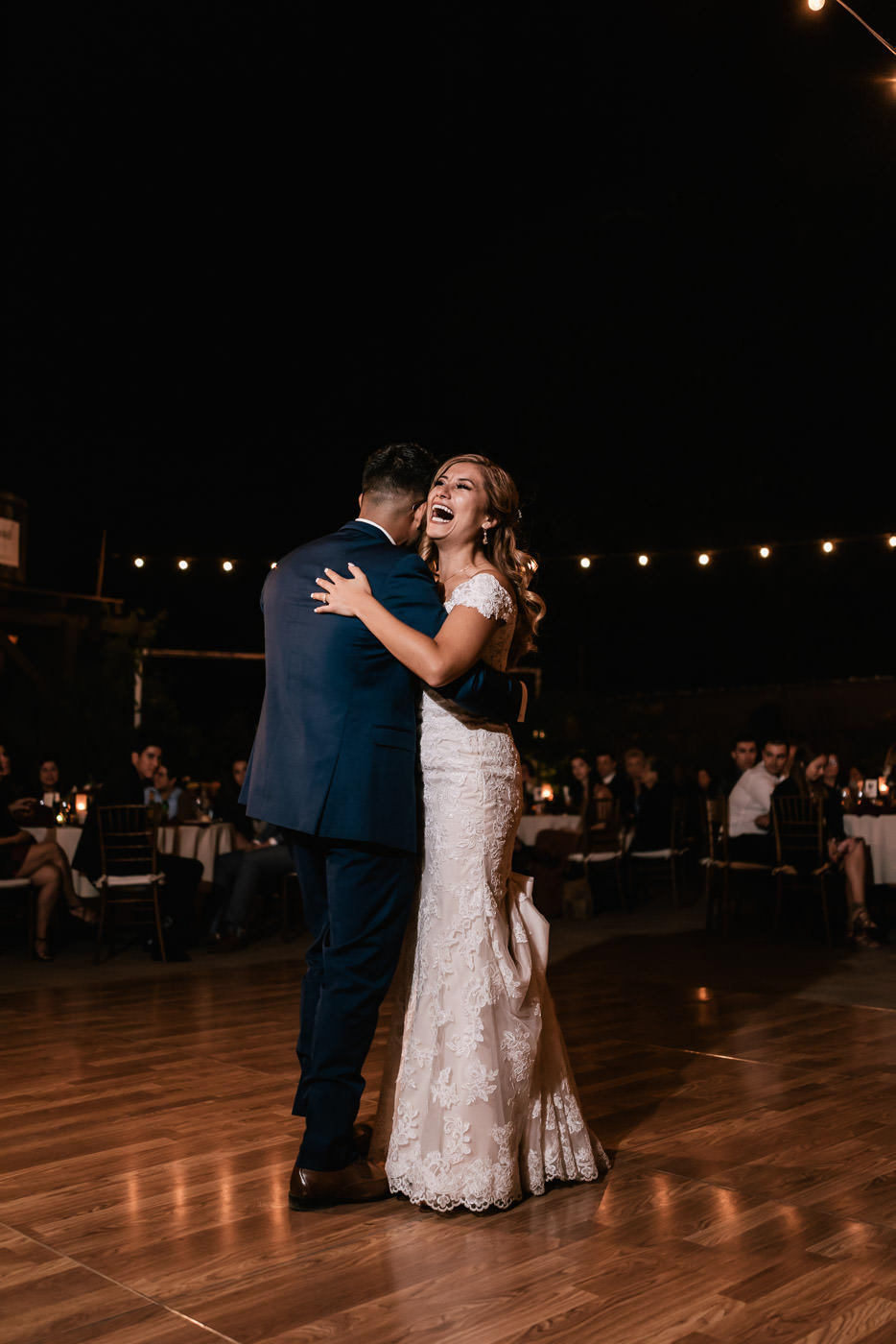 Bride laughs out loud as she dances with her brother at the reception at The Homestead.