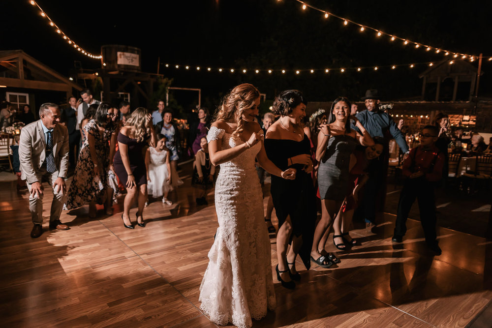 Bride tears up the dance floor at her rustic reception at The Homestead.
