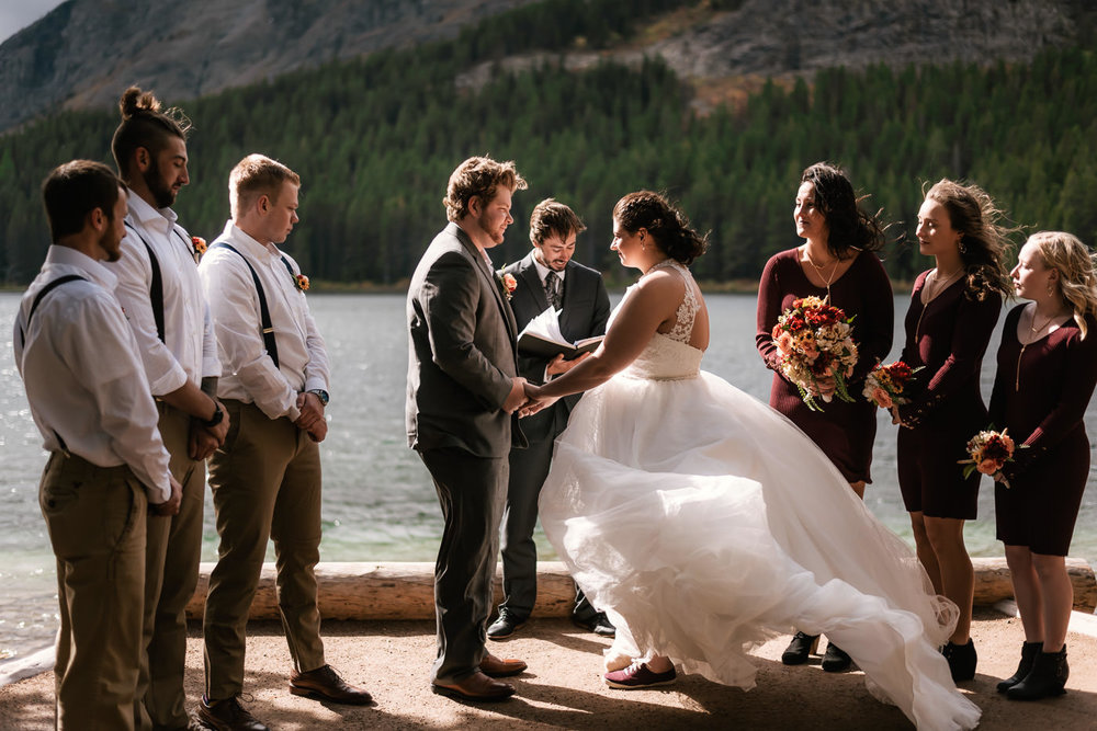 """A little broken, but unbeaten - This one was certainly a first for me as an elopement photographer. A few weeks before my flight out to Montana I received an email from Ashley and when I read """"I have broken my leg"""" I assumed the next line would read """"so we have canceled our elopement to Glacier National Park."""" But oh no, the elopement was still on and Matt and Ashley weren't going to let some broken bones mess with their romantic escape to Montana's pristine wilderness. With a lot of guts, and some truly great friends, they made this an elopement all of us will never forget."""