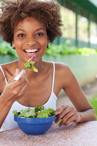 girl eating salad.jpg