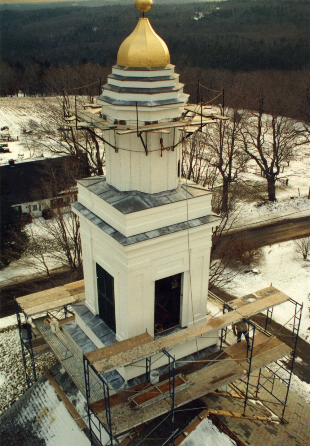 Two stacked cupolas with an eight sided dome atop