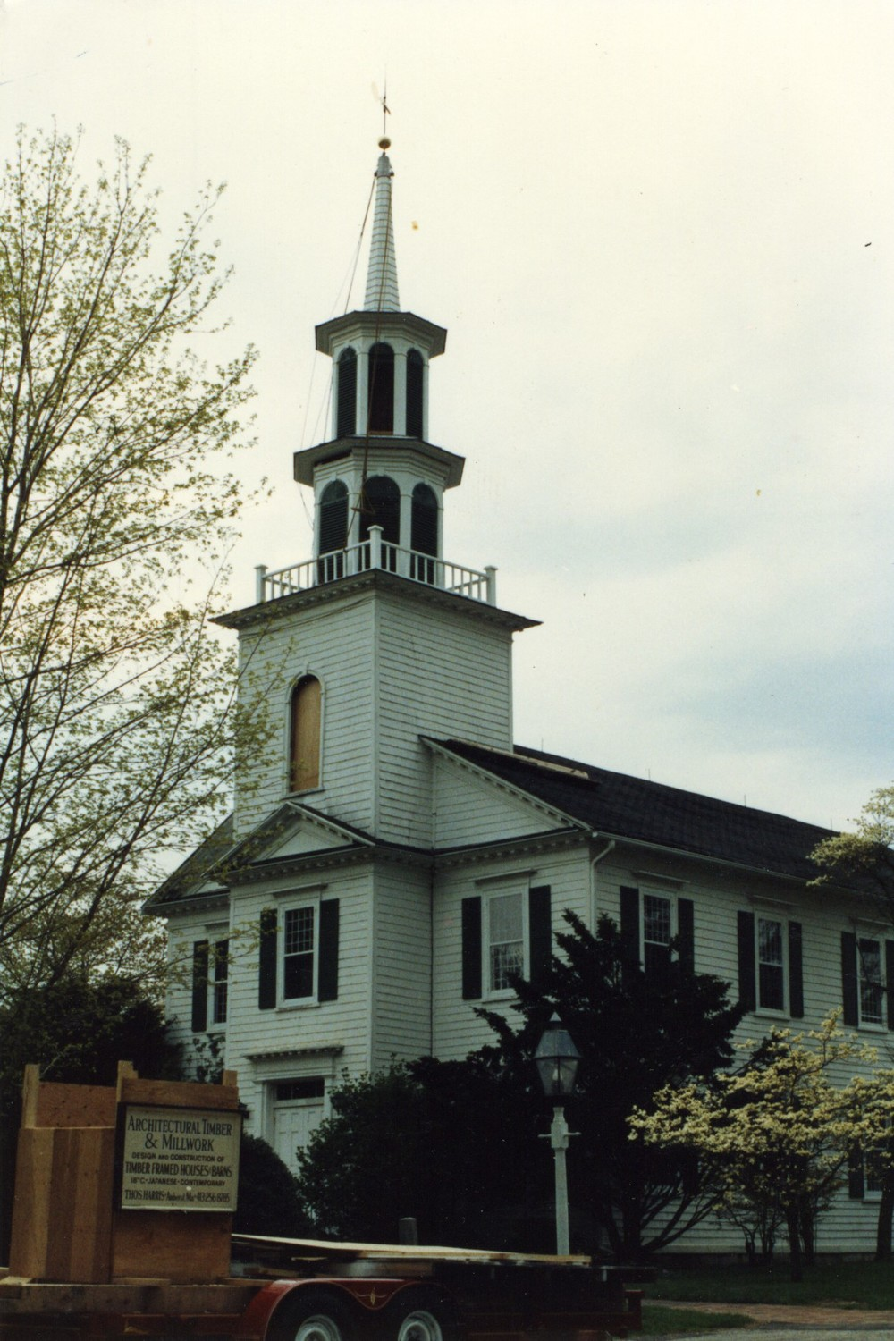 A two cupola steeple with spire atop narthex.
