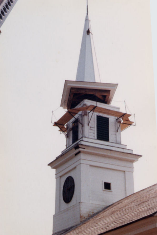 A two cupola steeple with a tall spire