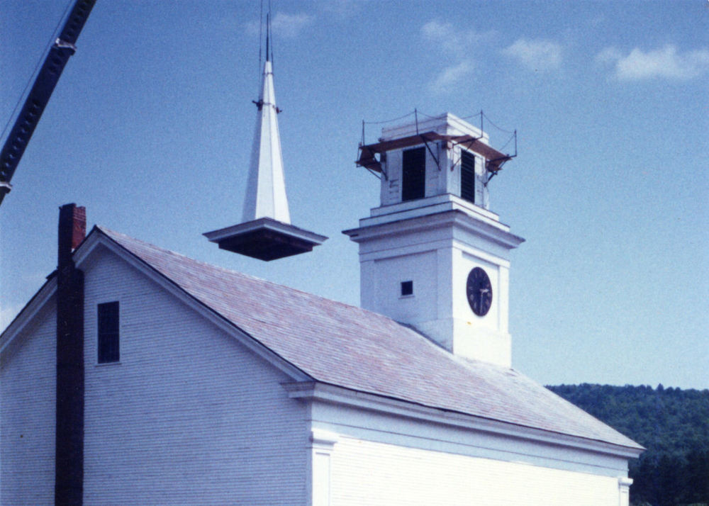 A two cupola steeple and a tall spire