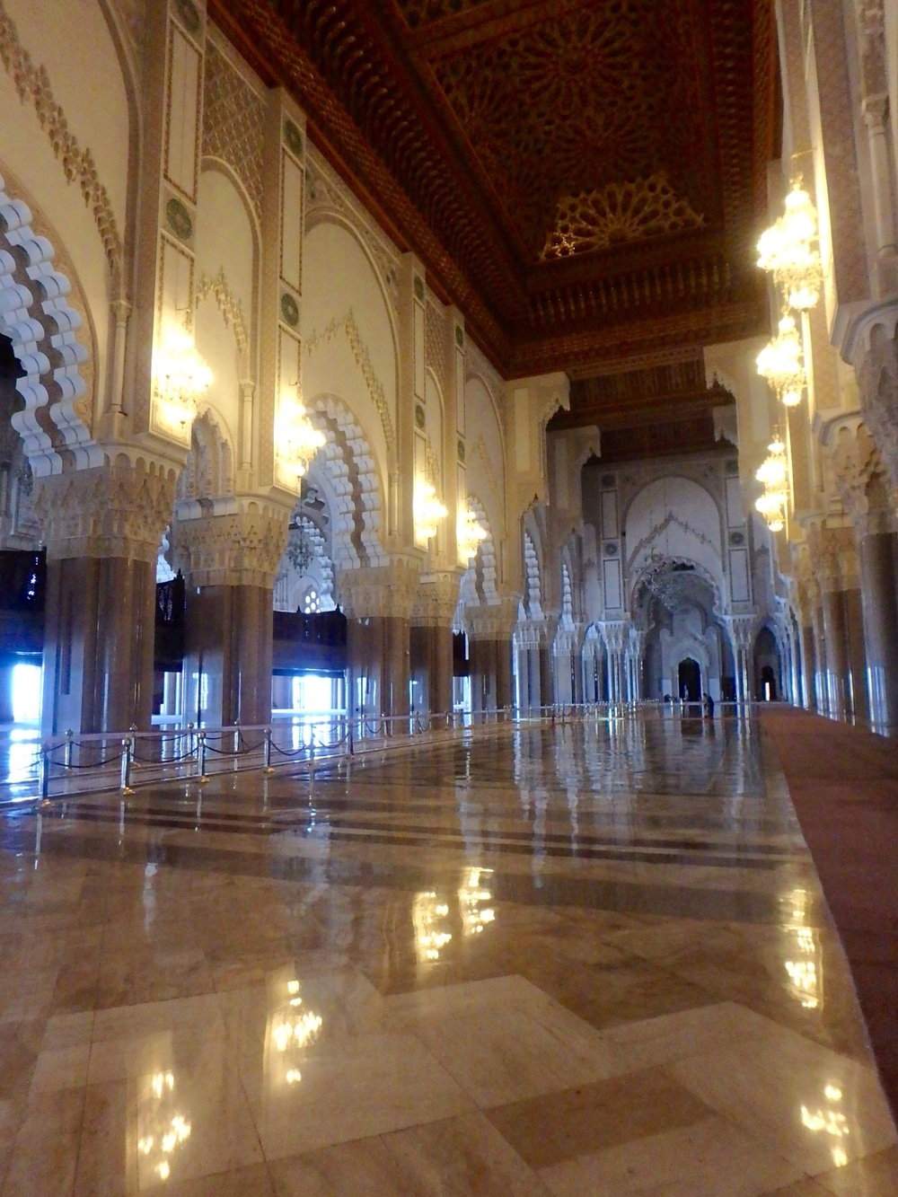 This is the main interior area of the mosque and the worship hall. The roof is decorative as well as functional - it retracts to help with air circulation for the 25,000 worshippers expected to arrive for Ramadan next week.