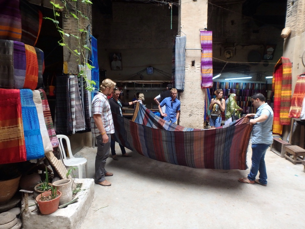 Buying linens in an artisan shop was a much better experience than being haggled on the crowded streets.