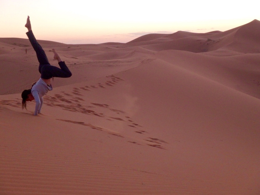 Playing on the sand dunes at dusk.