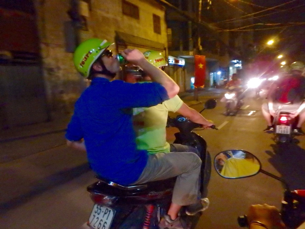 Jonathan enjoys a very light beer on the back of the motorbike, which is legal in Vietnam. Don't worry, drivers aren't afforded the same luxury.