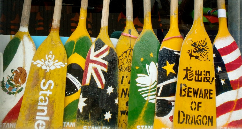 """Our first seaside find was these painted paddles. My favorite? """"Beware of Dragon."""" Of course."""