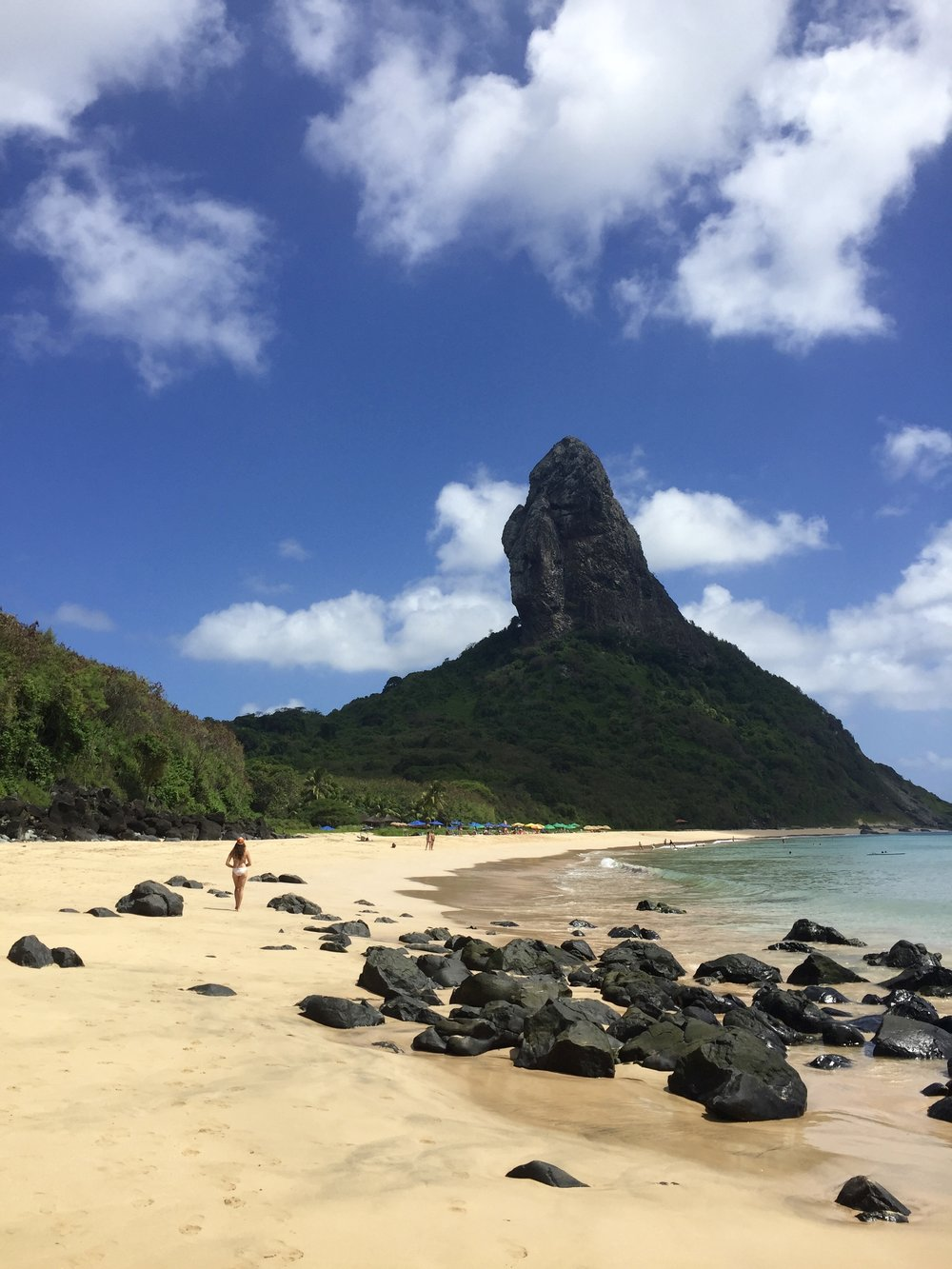 Fernando de Noronha's Praia da Conceição, with Morro do Pico in the background.