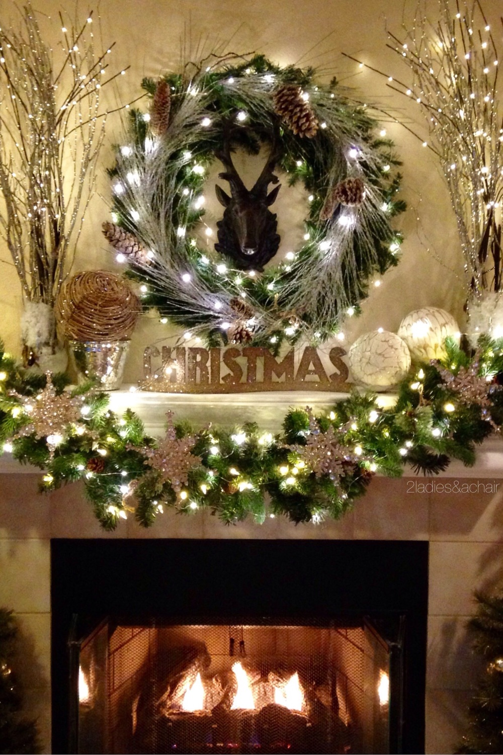 we like to start our christmas decorating with the mantel it is the focal spot of most homes as soon as we saw this faux deer at homegoods we knew this