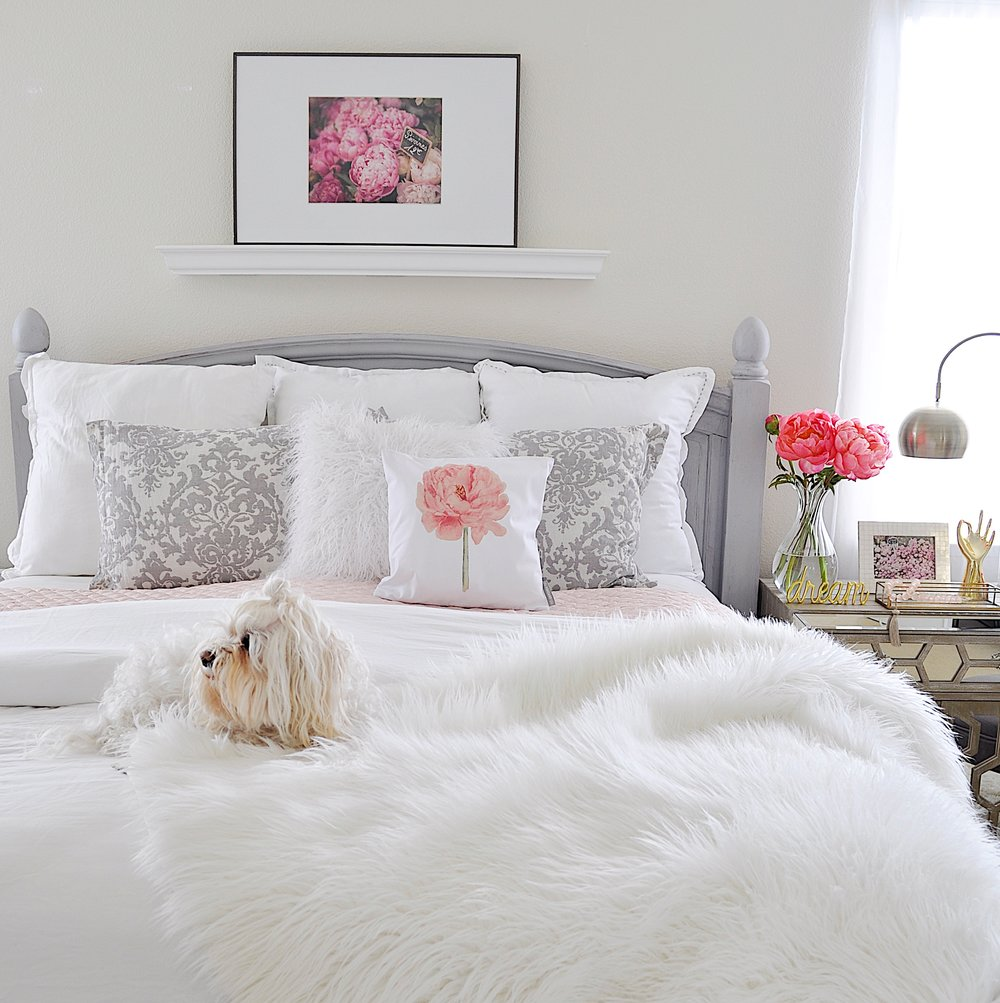 All white bedding with a touch of blush has the luxurious feeling of a resort; Carmen loves it!