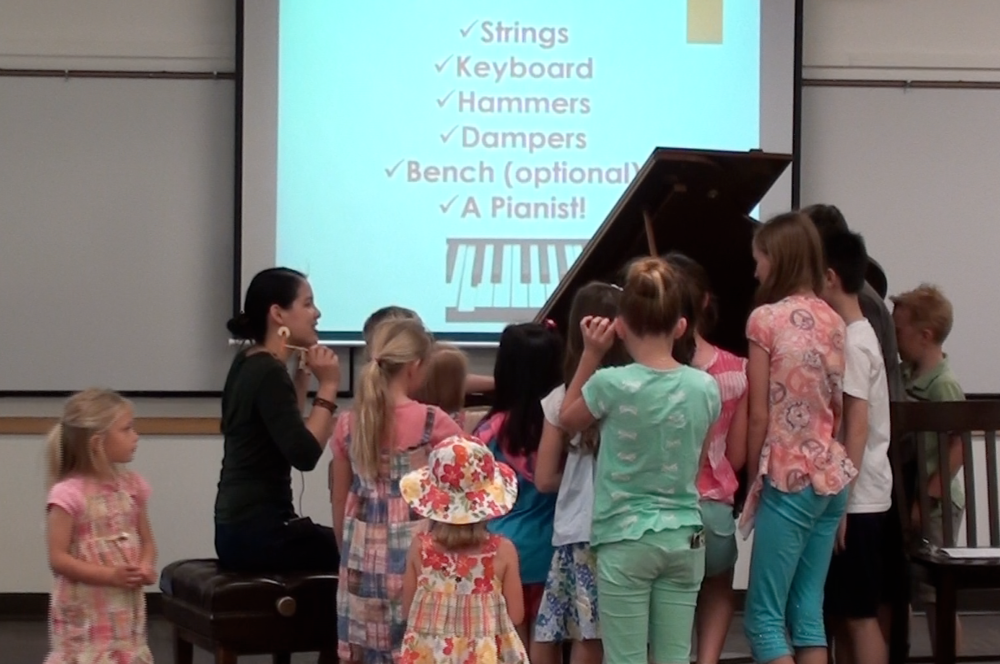Playing inside of piano with hammers!