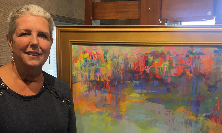 "Barbara Stone with her pastel painting ""In Spirit"" which won First Place in the Bay State Open national juried show at the Cape Cod Art Center in Barnstable in June 2018. It was also voted the coveted ""People's Choice"" award for best painting in the show, which had about 400 entries with only 80 on exhibition."