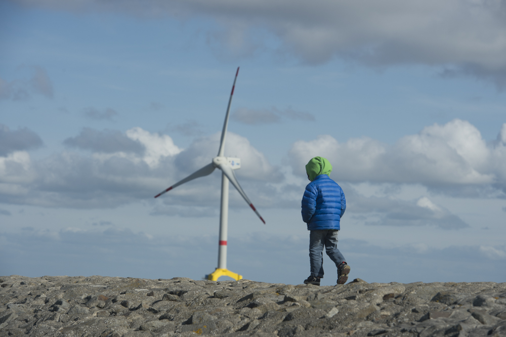 Boy and a wind turbine
