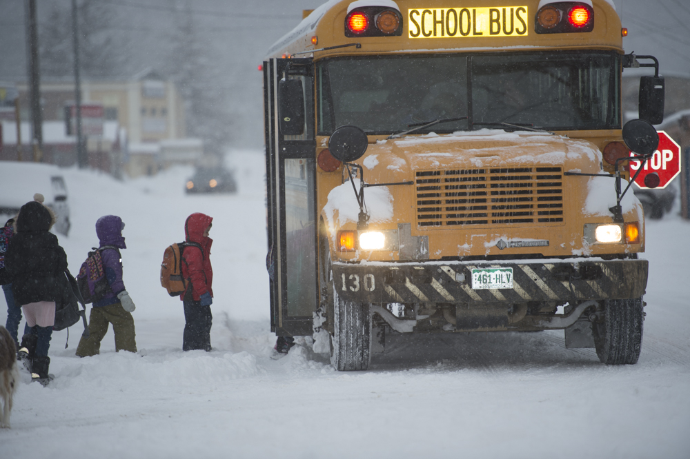 Catching the school bus in a snowstorm in Colorado