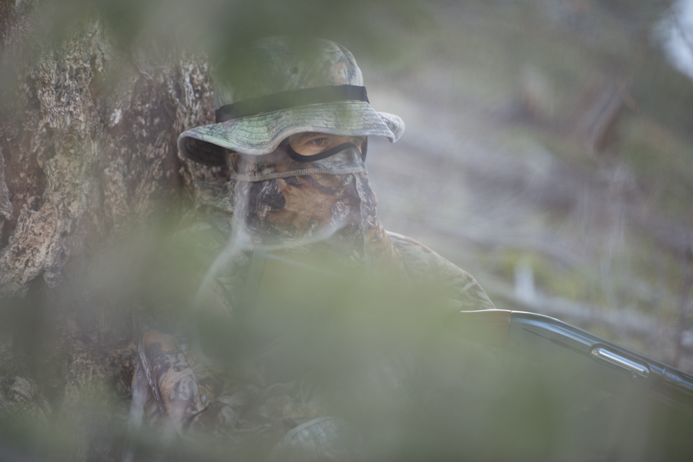 A turkey hunter hiding
