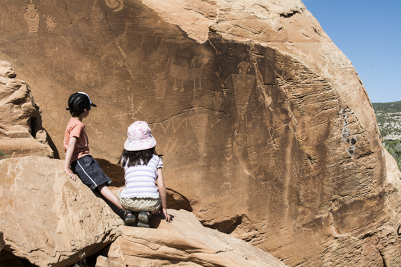Six-year-olds and somewhat older petroglyphs in Dinosaur National Monumant.