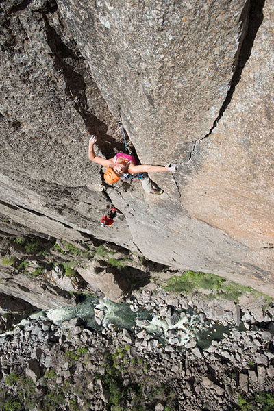 Photo of Jen Olsen and Anthony Everhart on Tague Yer Time, 5.12, in Colorado's Black Canyon of the Gunnison, during June, 2013.